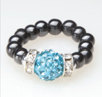 black beaded stretch ring with blue crystal accent bead