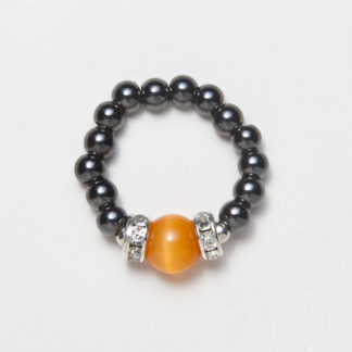 black beaded stretch ring with cats eye orange accent bead