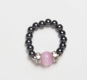 black magnetic stretch ring with pink cats eye accent bead