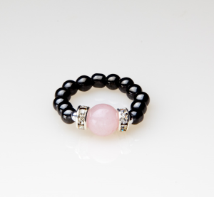 black beaded stretch ring with rose quartz accent bead