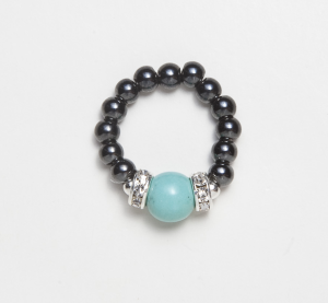 black beaded stretch ring with turquoise ball accent bead