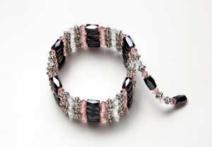 light pink, crystal, and black magnetic wrap