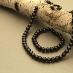 black magnetic ring, bracelet, and necklace set
